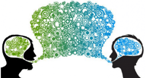 two brains with a speech bubblle symbolising communication