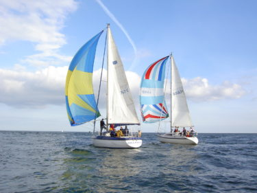 Two sailing boats on the open sea