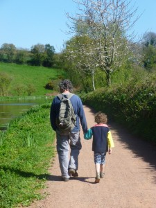 Father and son walking beside the Canal.