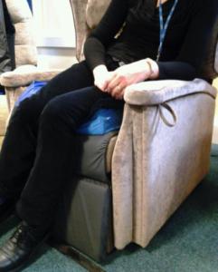 sitting in a slsideways slumped position